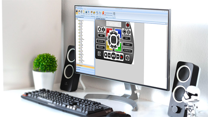 A computer on a desk showing the DemoPad Designer user interface